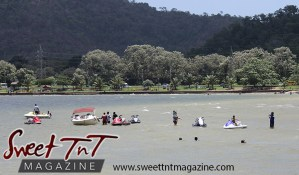 Jet skis, boat, children in water, mountains, trees at Chaguaramas Beach in Sweet T&T, Sweet TnT Magazine, Trinidad and Tobago, Trini, vacation, travel Chaguaramas Boardwalk