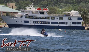 Jet ski, man and woman by boat Treasure Queen Too blue and white in water at Chaguaramas Beach in Sweet T&T, Sweet TnT Magazine, Trinidad and Tobago, Trini, vacation, travel Chaguaramas Boardwalk