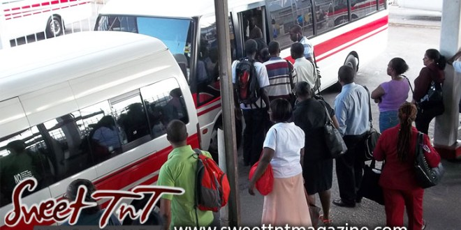 People after work waiting for transport, red band Maxi Taxi bus station at City Gate, Port of Spain. Drivers.