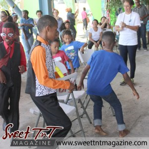 Boys play musical chairs at special needs children Easter Bonnet parade at Queen's Park Cricket Club, color eggs, Sweet T&T, Sweet TnT, Trinidad and Tobago, Trini, vacation, travel