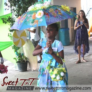 Girl in blue dress, special needs children at Easter Bonnet parade at Queen's Park Cricket Club, disney characters on umbrella, Sweet T&T, Sweet TnT, Trinidad and Tobago, Trini, vacation, travel