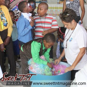 Boy dig in brand tub of toys at special needs children Easter Bonnet parade at Queen's Park Cricket Club, color eggs, Sweet T&T, Sweet TnT, Trinidad and Tobago, Trini, vacation, travel