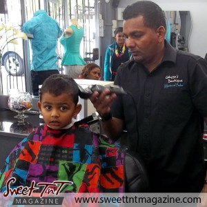 Barber Faisal Mohammed, Master of Fades trims boy in salon, Sweet T&T, Sweet TnT, Trinidad and Tobago, Trini, vacation, travel