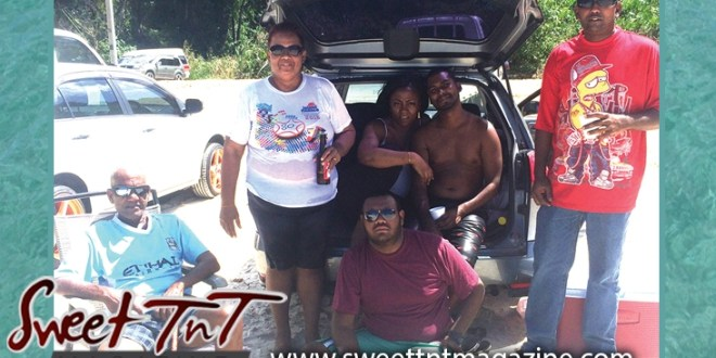 Family at Tyrico Beach, Felesha Subadar, Parboo, people wearing dark shades, couple hugging in van, Indian man wearing red Bart Simpson t shirt, granny holding drink, grandpa sitting on beach, fat man sitting on beach, Indian family, in parking lot at North Coast, in Sweet T&T, Sweet TnT, Trinidad and Tobago, Trini, vacation, travel