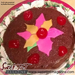 Fruit cake with cherries and pink and yellow flowers on a plate by Radha Ramoutar, Sweet T&T, Sweet TnT, Trinidad and Tobago, Trini, vacation, travel