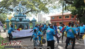 Hosay blue float, solo, dancing, muslim men dance in Sweet T&T, Sweet TnT, Trinidad and Tobago, Trini, Travel, Vacation, Tourist, Hosay, Muslim, Parade, Tomb, Drummers, Funeral Procession, Woodbrook, St James, St Clair, Palm, Dancing the moon, Tadjahs, Moons, Tadjahs, mosques, Hussein, Hassan, tombs, tassa side, two moons, Husayn, Hassan