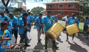 Hosay Muslim men dance, beat drums, Sweet T&T, Sweet TnT, Trinidad and Tobago, Trini, Travel, Vacation, Tourist, Hosay, Muslim, Parade, Tomb, Drummers, Funeral Procession, Woodbrook, St James, St Clair, Palm, Dancing the moon, Tadjahs, Moons, Tadjahs, mosques, Hussein, Hassan, tombs, tassa side, two moons, Husayn, Hassan
