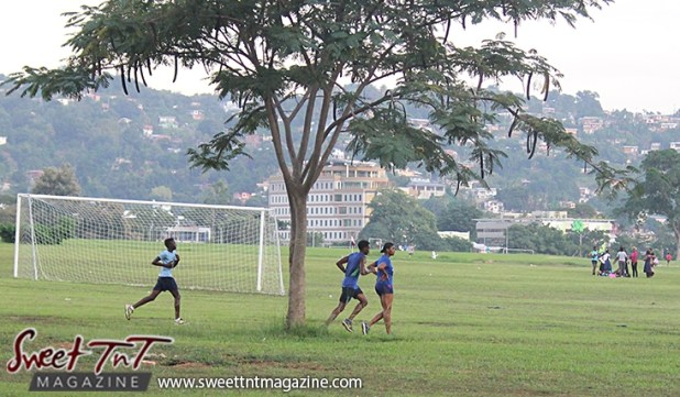Woman and 2 men jogging Queens Park Savannah Port of Spain for How to lose weight story in Sweet T&T, Sweet TnT, Trinidad and Tobago, Trini, vacation, travel