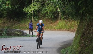 Cyclist and woman exercising on Lady Chancellor Hill Port of Spain for story original outdoor gym in Sweet T&T, Sweet TnT, Trinidad and Tobago, Trini, vacation, travel
