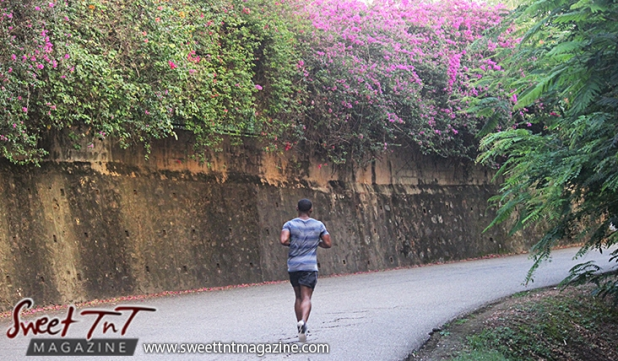 Man jogging on Lady Chancellor Hill Port of Spain for story original outdoor gym in Sweet T&T, Sweet TnT, Trinidad and Tobago, Trini, vacation, travel