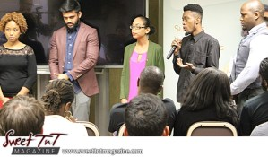 Entrepreneur with mic makes presentation to audience at Launch Rockit business in 54 hours in sweet t&t for Sweet TnT Magazine in Trinidad and Tobago