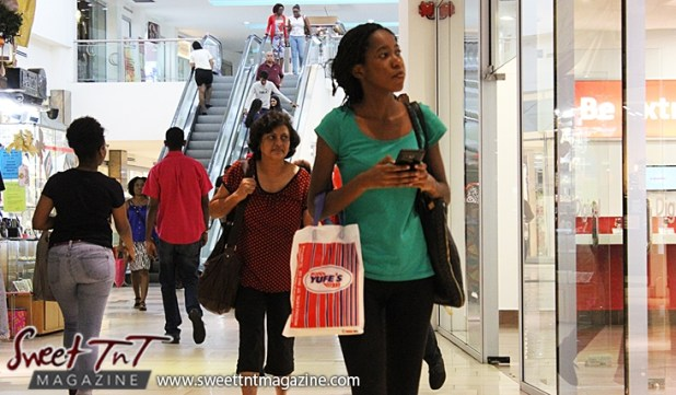 Woman shopping with Yufes bag at Trincity Mall in sweet T&T for Sweet TnT Magazine, Culturama Publishing Company, for news in Trinidad, in Port of Spain, Trinidad and Tobago, with positive how to photography.
