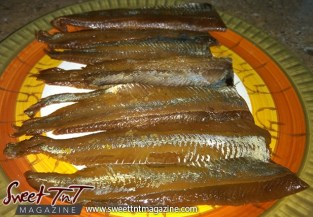 Smoked herring on plate in sweet T&T for Sweet TnT Magazine, Culturama Publishing Company, for news in Trinidad, in Port of Spain, Trinidad and Tobago, with positive how to photography.