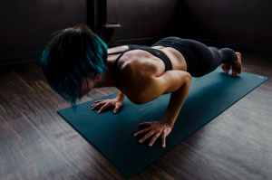 Train at home and stay safe, woman doing push ups