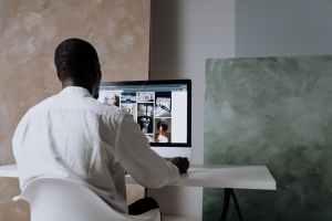 man browsing pexels on an imac