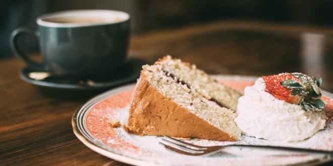 Photo of sliced cake on ceramic plate. Diabetic cake.