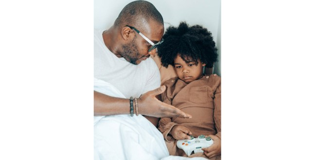 Temper tantrum. Black father speaking with child at home