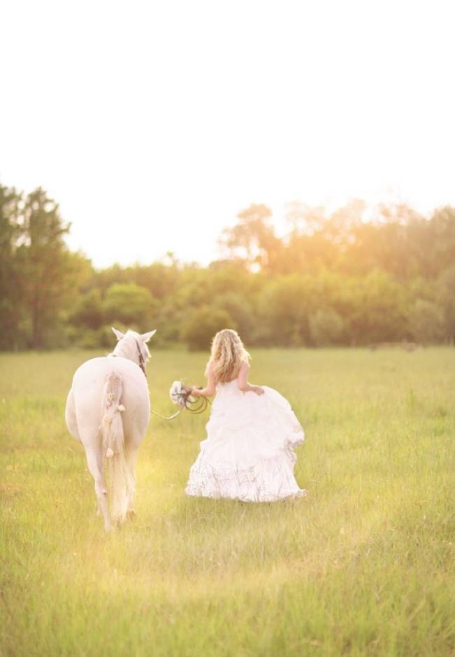 bride walking horse through field