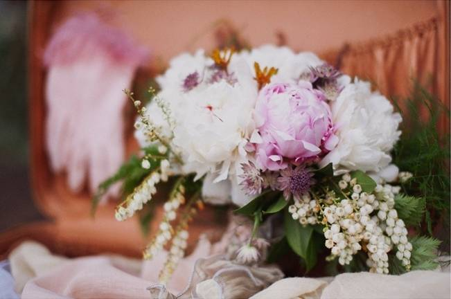 pink peony and lily of the valley bouquet