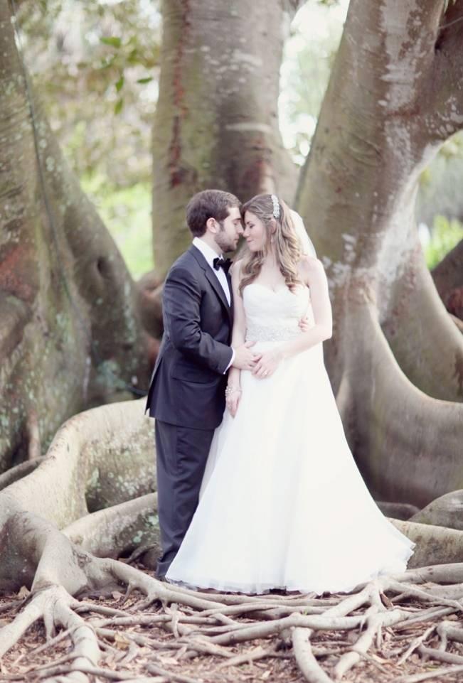 bride and groom under banyan tree