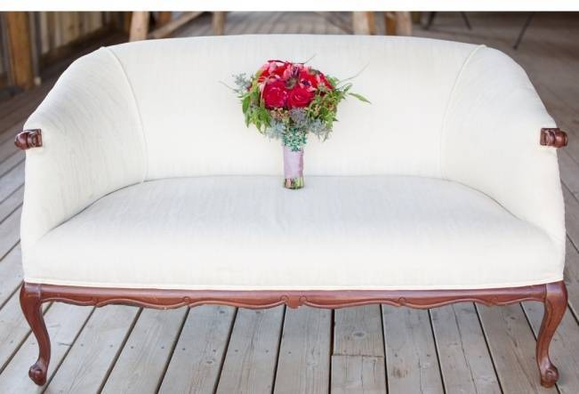snow white settee with red flowers