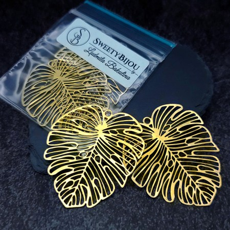 Pair of large vintage golden color exotic leafs charms