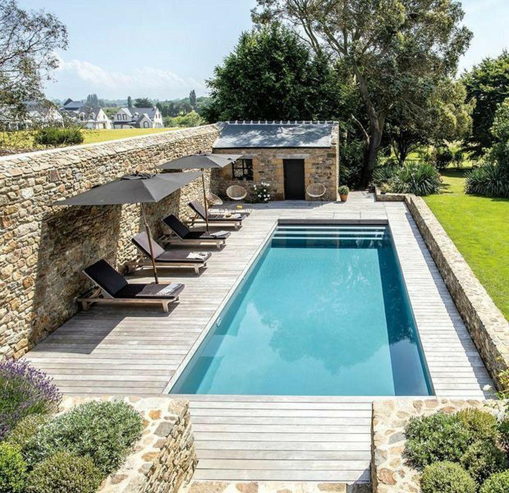 Stunning Backyard Pool Landscaping Ideas 11