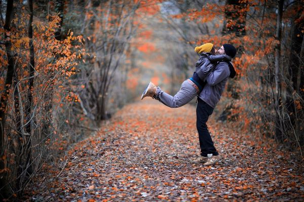 young people hugging in the autumn park