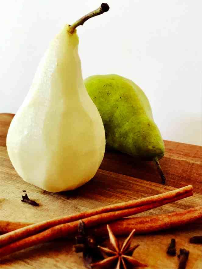 Preparing pears poached in red wine