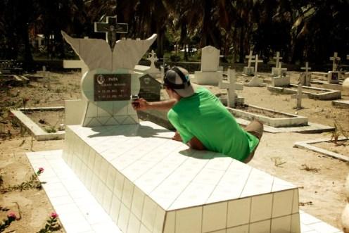Raiarii visiting his grandfather's grave.