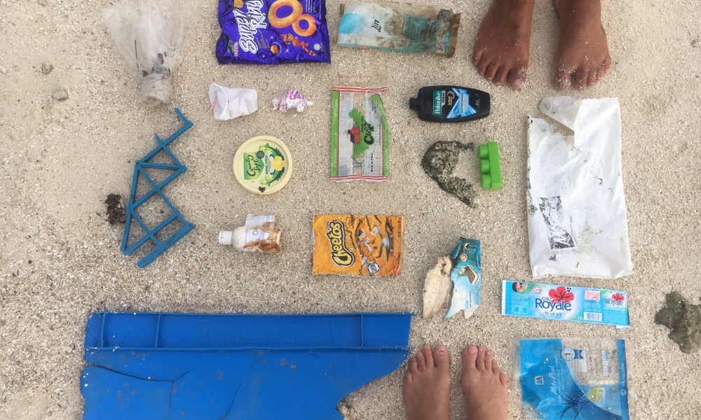 Tahui and I collected this on ONE trip across the lagoon! Not only does this plastic packaging pollute, most of this stuff isn't good for our health to use or consume either!