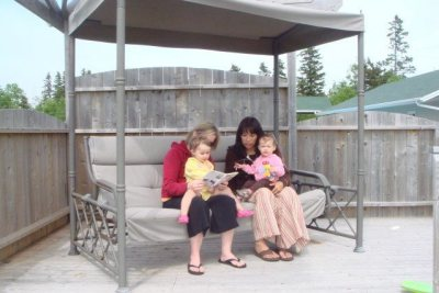 Me and mom time reading on the swing