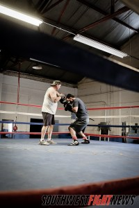 "Abraham ""Abie"" Han working with Coach Louie Burke"