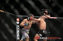 Left Hook from Dodson staggers Demetrious Johnson. Photo: Will Fox/MMAWeekly