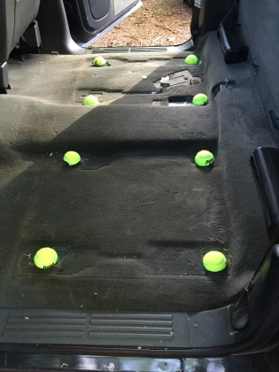After removing the seats, there were 8 large bolts sticking out of the floor, so I cut some tennis balls in half to cover them
