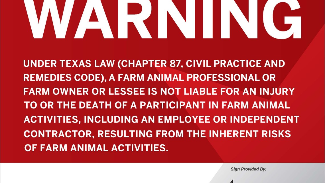A red background sign that states: Warning. Under Texas law (chapter 87, civil practice and remedies code), a farm animal professional or farm owner or lessee is not liable for an injury to or the death of a participant in farm animal activities, including an employee or independent contractor, resulting from the inherent risks of farm animal activities