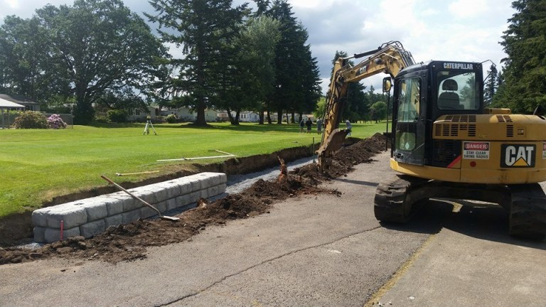 landscaping services with an excavator