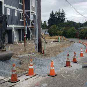 cones along a area that is prepped for sidewalks