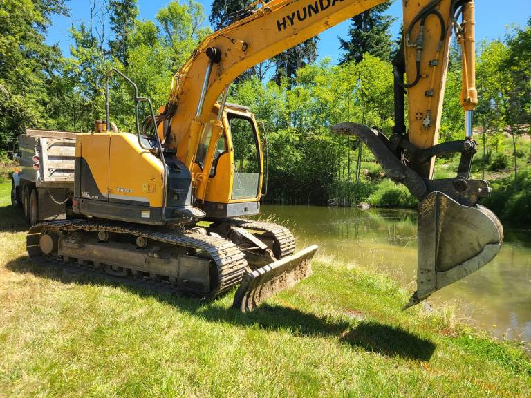 excavator on property How Much Does Land Excavation Cost