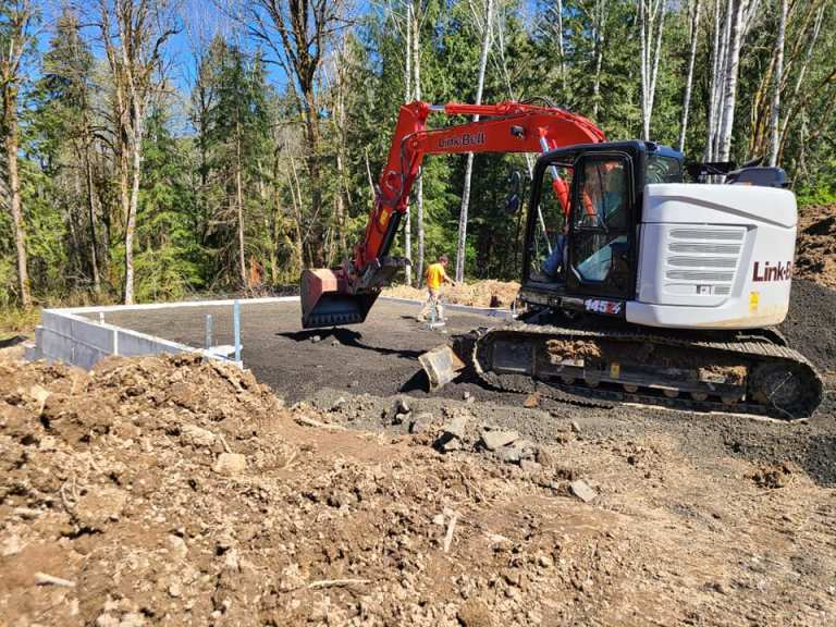 Swick and son excavator work at a custom home building project