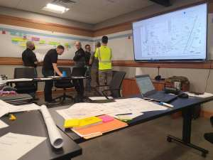 Swick and Son team in meeting room doing construction planning