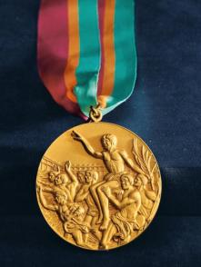 CARL LEWIS OLYMPIC GOLD MEDAL - This is one of the four gold medals awarded to Lewis in 1984, when he matched Jesse Owens's achievement. (Credit: All Artifacts from the collection of the Smithsonian National Museum of African American History and Culture / Photo by Bettman Archive / Getty Images / Gift of Carl Lewis)