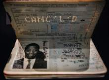 JAMES BALDWIN'S PASSPORT - Poet, playwright, and Civil Rights activist James Baldwin's passport. (Credit: All Artifacts from the collection of the Smithsonian National Museum of African American History and Culture/ Photo by Lexey Swall / New York Times)