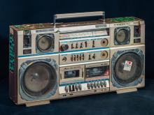 "PUBLIC ENEMY'S BOOM BOX - Chuck D bought this cassette player in 1987 in New York City before the group released its landmark album, It Takes a Nation of Millions to Hold Us Back. Used on tour until the mid-1990s, it returned for a 2010 tour. After that, Chuck D says, ""there's only one place it could go."" (Credit: All Artifacts from the collection of the Smithsonian National Museum of African American History and Culture / Gift of Public Enemy.)"