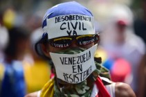 A demonstrator against President Nicolas Maduro's government during a protest on the east side of Caracas on April 19, 2017. (Photo: Ronaldo Schemidt / AFP / Getty)