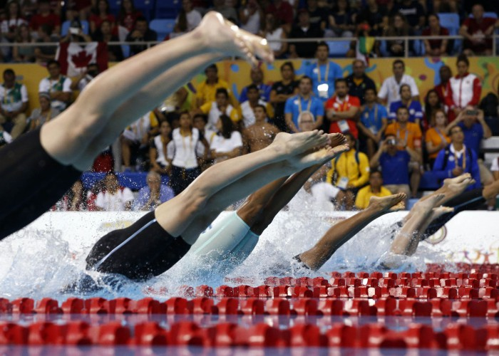 Jul 17, 2015; Toronto, Ontario, CAN; A view of the feet of the competitors as they dive in at the start of the women's 50m freestyle final the 2015 Pan Am Games at Pan Am Aquatics UTS Centre and Field House. Mandatory Credit: Rob Schumacher-USA TODAY Sports