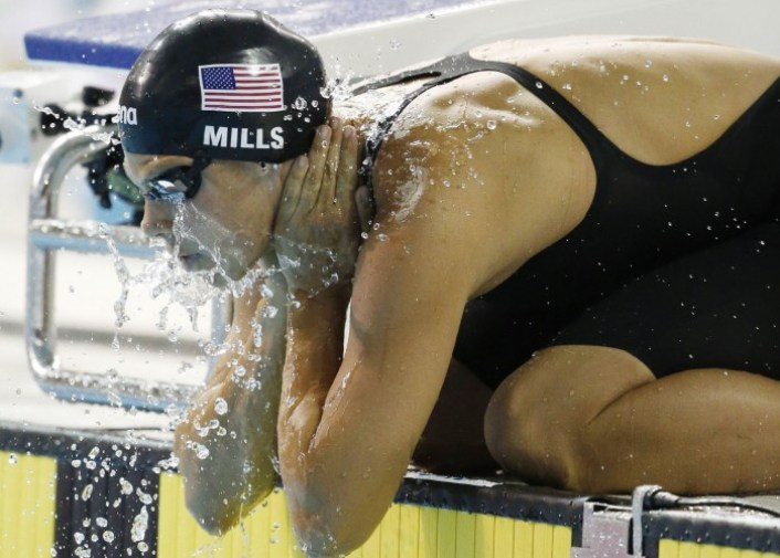 Jul 14, 2015; Toronto, Ontario, CAN; Katherine Mills of the United States splashes herself with water before the women's 200m butterfly swimming final during the 2015 Pan Am Games at Pan Am Aquatics UTS Centre and Field House. Mandatory Credit: Erich Schlegel-USA TODAY Sports