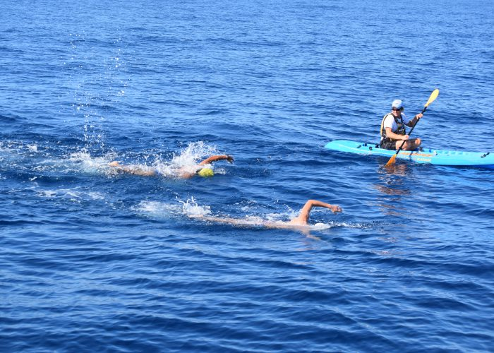 sbchan-two-swimmers-kayak-open-water
