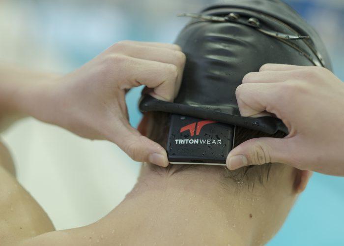 Swimming Technology TritonWear training device on swimmer's head
