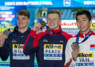 (L-R) Second placed James Wilby of Great Britain, winner Adam Peaty of Great Britain and third placed Zibei Yan of China pose with their medals after competing in the men's 100m Breaststroke Final during the Swimming events at the Gwangju 2019 FINA World Championships, Gwangju, South Korea, 22 July 2019.